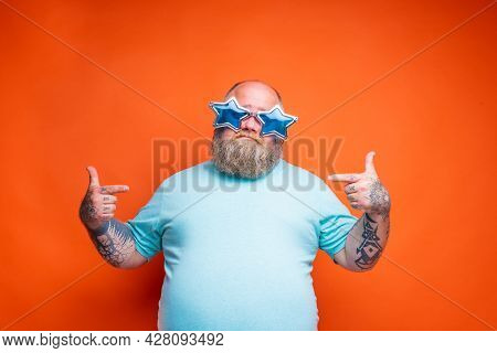Fat Doubter Man With Beard, Tattoos And Sunglasses Is Uncertain For Something
