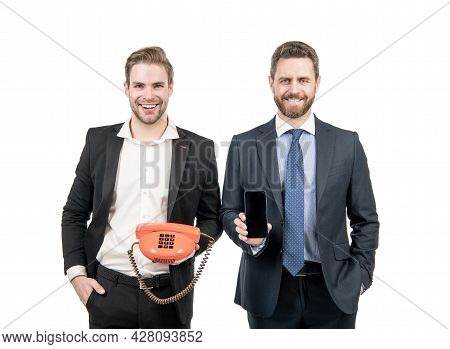 Which Device Is Best. Men Hold Mobile Phone And Telephone. Using Cellphone Or Vintage Telephone