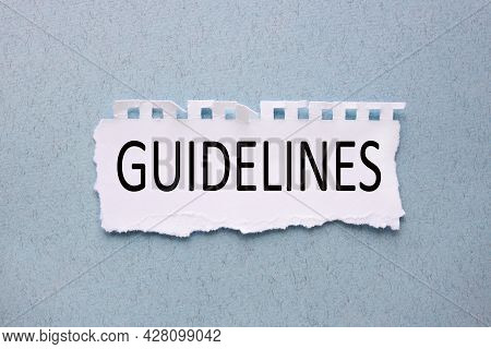 Guidelines, White Torn Paper With Text On Blue Background