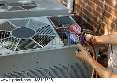 Air Conditioning Technician Servicing Of Preparing To Air Conditioner