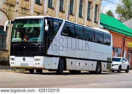 Beliov, Russia - July, 3, 2021: tourist bus parking in the center of Beliov, Russia