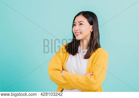 Young Asian Beautiful Woman Smiling Wear Silicone Orthodontic Retainers On Teeth With Crossed Arms,