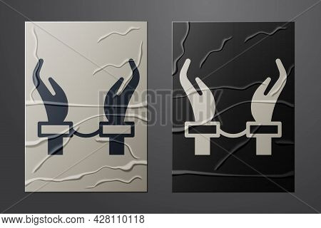 White Handcuffs On Hands Of Criminal Man Icon Isolated On Crumpled Paper Background. Arrested Man In