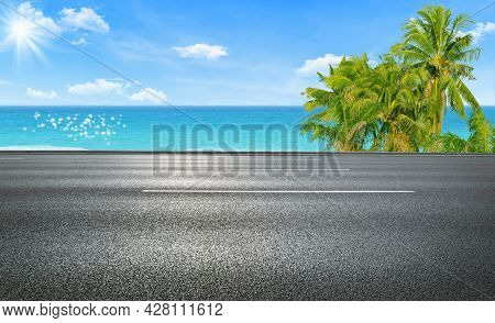 Side View Of Asphalt Straight Street Roadway Of Lanes With Lines And Seascape View In Background.