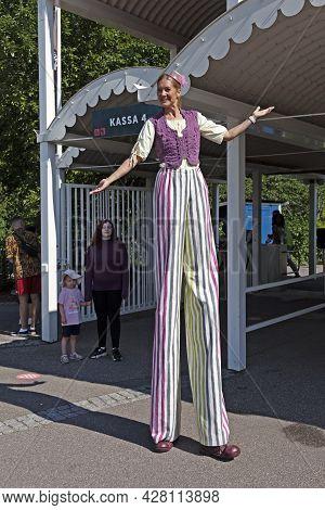 Gavle, Norrland Sweden - July 10, 2021: Entertainer Walking On Stilts Outside The Amusement Park