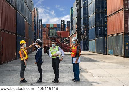 Engineer Worker Wearing Surgical Mask Checking Body Temperature Using Infrared Digital Thermometer C