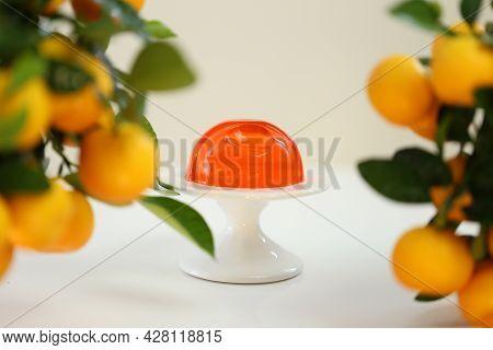 Mandarin Jelly Dessert. Citrus Fruit Jelly On A Tangerine Bush On A Light Beige Background. Diet Low