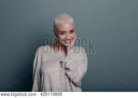 Millenial Young Woman With Short Blonde Hair Smiling Portrait With Hands Touching Face Skin