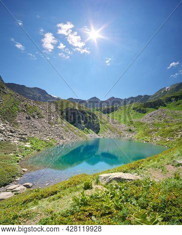 The beautiful summer landscape of Caucasus mountain. Dukka lakes near Arkhyz village in Russia. Daylight mountain landscape.