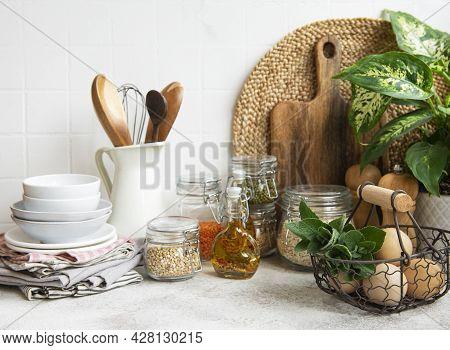 Kitchen Utensils, Tools And Dishware On On The Background White Tile Wall. Interior, Modern Kitchen