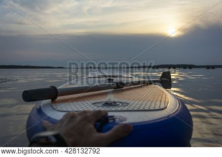 Sup Board, Paddle Board With A Paddle In The Sunset Light On The Background Of Water Close-up. Sup B