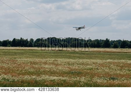 Plane Flying In The Sky Over The Airfield. Landing On The Aerodrome. Extreme Active Sport. Small Avi