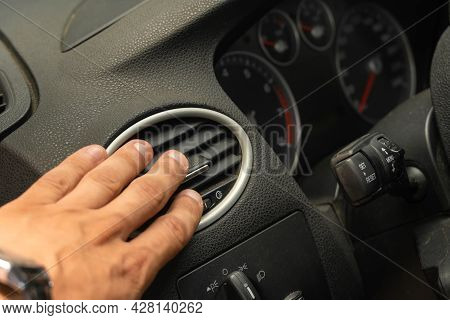 Male Hand Close-up Adjusts The Air Conditioner In The Car, Car Interior
