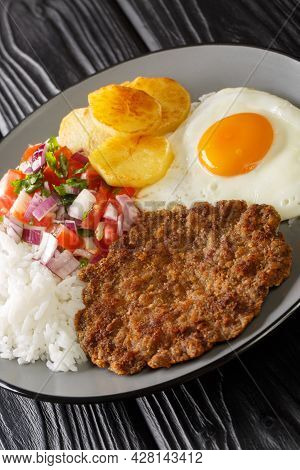 Silpancho Is An Incredible Bolivian Meal Made Of Rice And Is Topped With A Pan Fried Burger, Salsa,