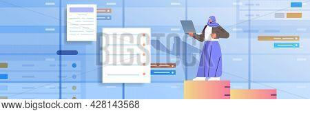 Arab Businesswoman Working On Laptop Business Planning Multitasking Time Management Concept