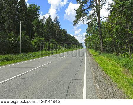 Picturesque Deserted Grey Asphalt Highway In Summer