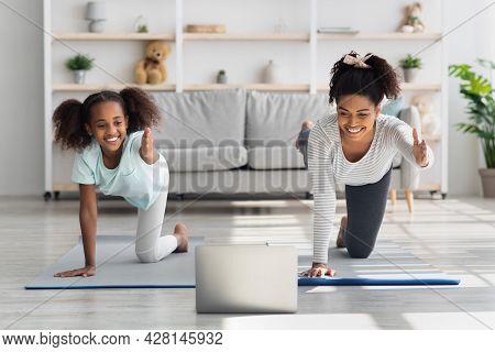 Beautiful Black Mom And Daughter Having Online Yoga Class