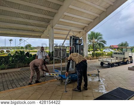 Cayo Coco, Cuba, May 16, 2021: The Hotel Tryp Cayo Coco Staff Prepares A Retractable Ladder For A Ro