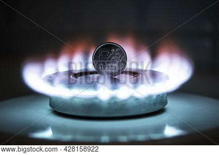 The Russian Ruble Is Burning In The Fire. Burning Gas Burner On The Background Of One Rubles. The Co