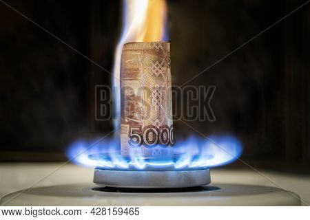 Russian Ruble Is Burning In The Fire. Concept The Rise In The Price Of Gas In Russia. A Bill Of 5000