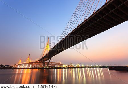 Huge Bridge And Reflection In Water At Twilight