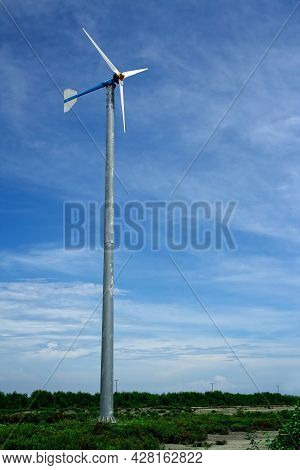 Wind Turbine And Blue Sky, Green And Clean Energy Concept.