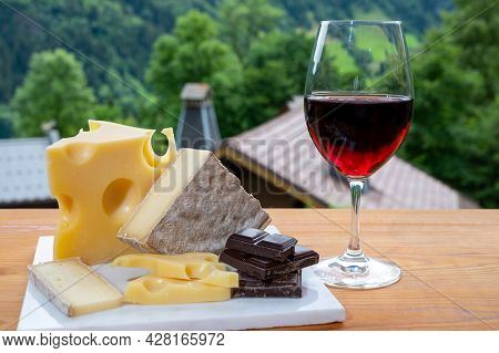 Cheese Collection, Swiss Cow Cheese Emmental, Tomme And Dark Chocolate, Glass Of Red Wine From Savoi