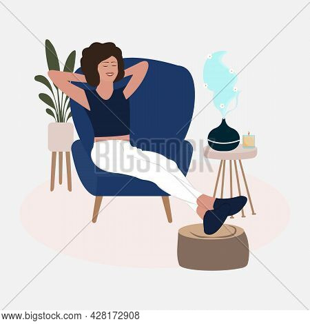 Women Relaxing On The Armchair While Enjoying The Aromatherapy