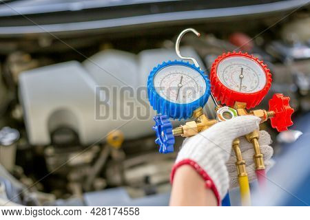 Air Conditioning Repair, Repairman Holding Monitor Tool To Check And Fixed Car Air Conditioner Syste