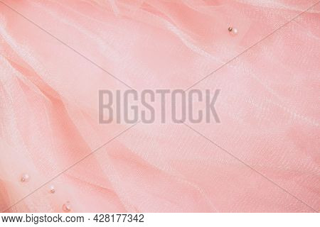 Beautiful Pink Tulle With Shiny Beads Background. Draped Background Of Pink Powdery Fabric, Texture.