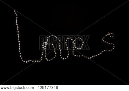 Love Message Written A Chain Of Gold Beads On A Black Background. Valentine's Day. Greeting Card