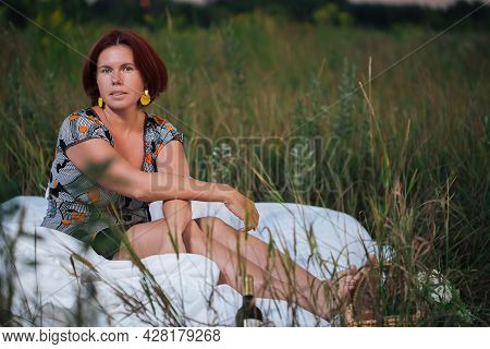 Charming Caucasian Woman 30-35 Years Old In The White Bed In A Field At Sunset