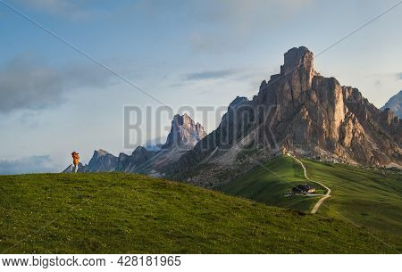 A Photographer Using A Camera Making A Beautiful Early Morning Dolomites Alps Mountain Landscape Pho