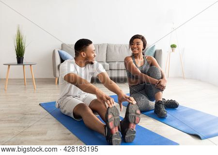 Athletic Black Couple Making Exercises On Sport Mats At Home, Full Length. Healthy Living Concept