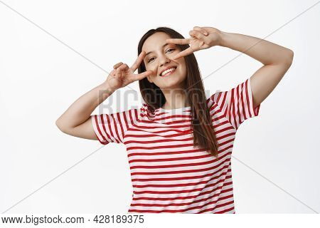 Beautiful Caucasian Girl Showing Peace V-signs Near Eyes, Smiling And Looking Happy, Positive Summer