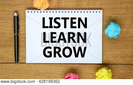 Listen, Learn, Grow Symbol. Words 'listen, Learn, Grow' On White Note On Beautiful Wooden Table, Col