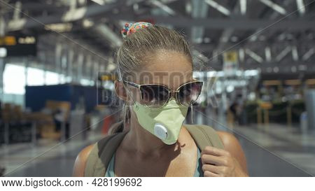 Woman Caucasian At Airport With Wearing Protective Medical Mask On Head Against The Background Of Th