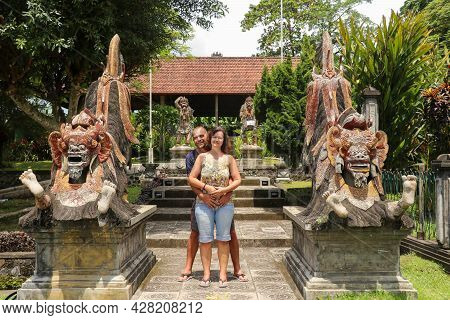 Bali, 23 March 2020 Tourist Couple In The Queen Garden Tirta Gannga. Amorous Middle Aged Couple Tirt