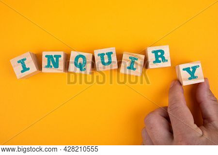 Inquiry. Wooden Blocks With Letters On A Yellow Background