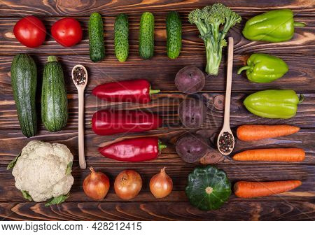 Bright Vegetables, Spoons, Forks, Knives In Knolling Style. Various Colourful Vegetables On Wooden B