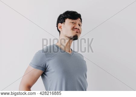 Insolent Denying Face Of Asian Man In Blue T-shirt Isolated On White Background.