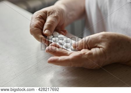 Sad Old Woman Taking Pills, Health Problems In Old Age, Expensive Medications. An Elderly Woman\'s H