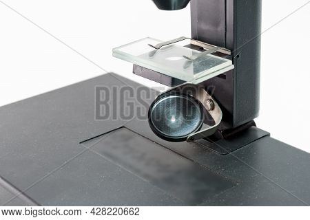 Substage Mirror Of Compound Microscope Reflecting Light To Illuminate The Reserch Object On Stage Wi