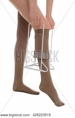 Woman Wearing Compression Tights With Donner On White Background, Closeup