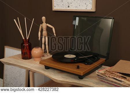 Modern Turntable With Vinyl Disc On Wooden Table Indoors. Interior Design