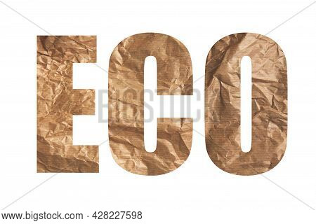 Word Eco Is Written Of Brown Crumpled Craft Paper On White Background. Sustainability And Eco Living