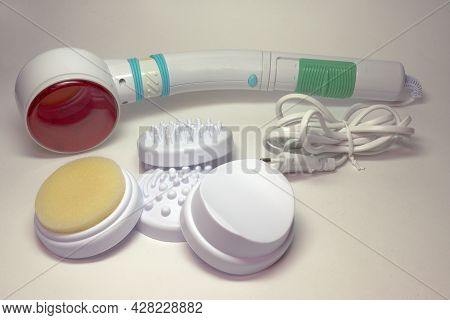 Massager With Heating. Handled Infrared Device For Body And Face Massage, With Different Attachments