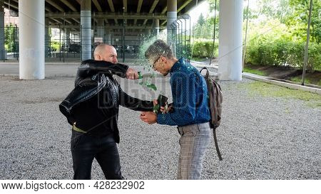 The Thug Breaks The Bottle On The Mans Head And Steals The Smartphone. Attack With The Purpose Of St