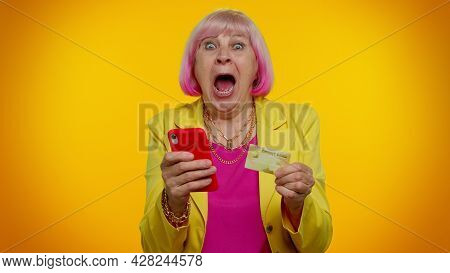 Senior Stylish Granny Woman Using Credit Bank Card And Smartphone While Transferring Money, Purchase