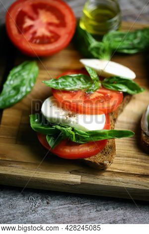 Delicious Caprese Sandwiches On A Wooden Board. Keto Sandwiches. Italy Diet.